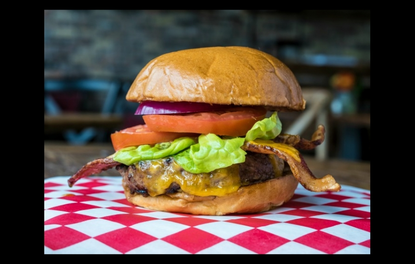 Blacks Market Table Grilled BMT burger made with 44 Farms beef