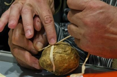 tying a white truffle